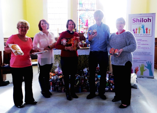 Members of Holy Trinity Church present harvest gifts to Jonathan Lang