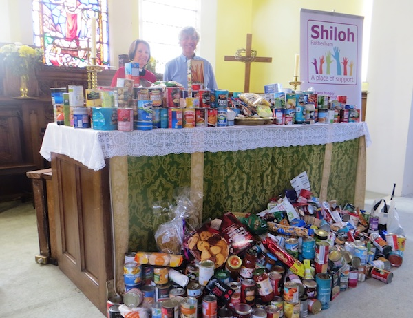 Rev. Lynn Broadhead and Jonathan Lang with Harvest Gifts from Holy Trinity Church