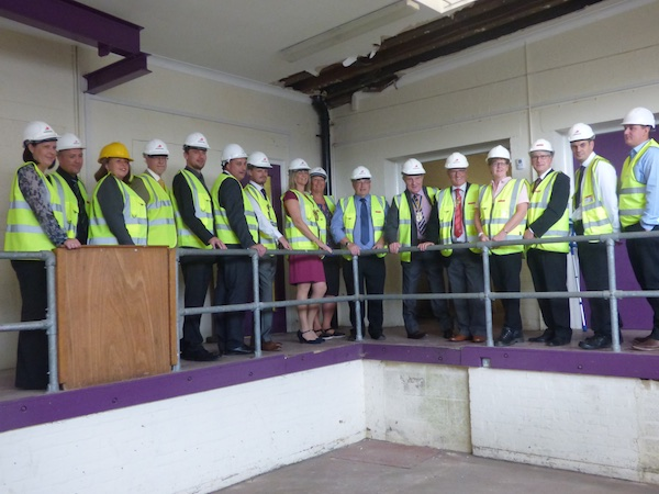 The Mayor Lyndsay Pitchley, Judy Dalton (Shiloh trustee) and John McDonnell flanked by representatives from the Council, Willmott Dixon, Mears, John Box Associates, Rotary club, the Probation Service and Shiloh trustees